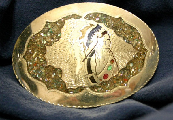 Crushed abalone encased in polymer resin on a nickel silver buckle using Western Freestyle hand engraving technique.
