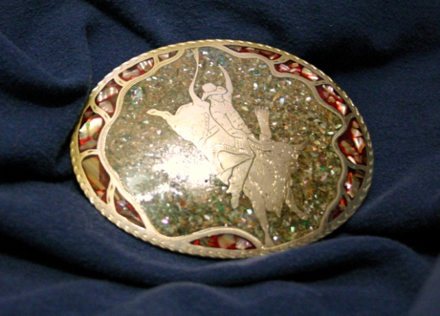 Nickel silver buckle with crushed abalone and polymer resin, Western Freestyle hand engraving.