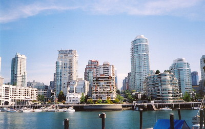 Across False Creek from Granville Island - glass crayons and ziggurats looms upward. The skyline looks similar to Hong Kong. The proximity to Asia and the influx of Hong Kong residents prior to the return of the province to China influenced construction in the region (2005).