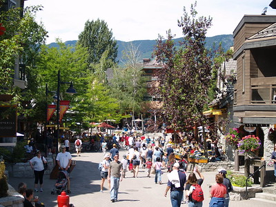 Bustling Whistler on a warm, sunny day. Known for its superior skiing in winter, Whistler is also a mecca for day-trippers from Vancouver when the weather is nice. Whistler is home to the outdoor venues during the 2010 Winter Olympics (2006).