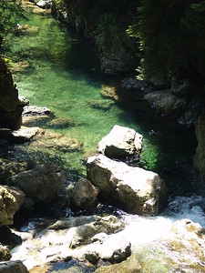 """This formation is called """"30 Foot Falls"""" and its pool. The stunning water color comes from the silt in the melting glacier water as it cascades down through Lynn Canyon. This is a beautiful area, popular with visitors and locals, that gets crowded very quickly (2006)."""