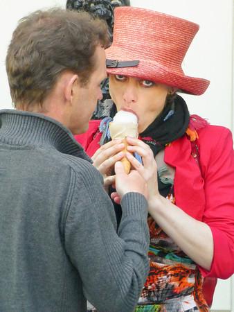 Amsterdam Jordaan Walk - women in red hat eating her husband's ice cream.