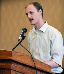 "Cameron Decker reads his poems, ""Everything Survives by Dividing"" and ""All of These are Facts,"" during the publication celebration for the 11th annual edition of The Laureate at Western Michigan University on April 9, 2012.  (Bradley S. Pines / CONTACT: bspines@gmail.com)"