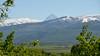 Tetons peek over the hills of Swan Valley