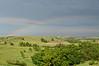 Thundershower creates rainbow, wet hills as we approach the park