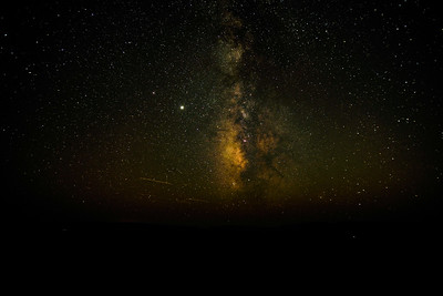 Milky Way and airplanes above Escalante desert