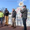 Harry Rock, at microphone, and Mayor Brian Sullivan, far right, honor Paul Asselin, Elm Electrical Sr. Project Manager, and Bruce Scheible, president of Westek Architectural Woodwok for their contributions to building the Westfield 350 cake.