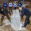 """oe Almeida, right,  of """"Sculpture In Ice, uses a chainsaw to carve a clock tower in ice, assisted by Tom Roy."""
