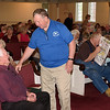 Cliff Gamble, seated, chats with Dick Baldwin at Wednesday night's Westfield 350 talk.