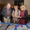 Bob Jensen and Barbara Braem-Jensen look over Westfield 350 merchandise assisted by Cindy Gaylord.