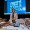 Gail Usher, research historian, poses with some of the artifacts she displayed during her talk Wednesday night at Westfield State University.