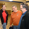 Brandon Wood, Bill Wood, and Ken Welker check out photos of Westfield's whip companies.