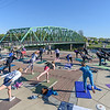 YMCA Yoga instructor Donna O'Connor leads a yoga sessiion at the green bridge Saturday morning.