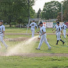 Starfire team members and coaches prepare the field for the game.