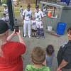 Kerri Houston gets a picture of her son Brendan with Starfire players Andrew Ciacciarelli and Thomas Quinn.