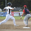 Danny Crossen (14) makes it safely to first base.