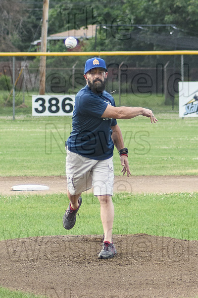 Dan Genovese, original member of the Westfield Wheelmen, throws out the first pitch at Saturday's Starfies game.