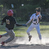 Elijah Dale (4) gets the out on a dusty play at second.