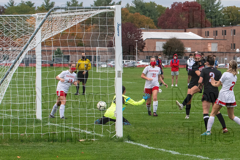 Chandler Pedolzky (9) blasts another ball past the Hampshire goalie and into the back of the goal. (BILL DEREN PHOTO)