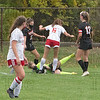 Westfield's goalie Morgan Fillion comes out to corral the ball with a Hampshire attacker looking for a loose ball. (BILL DEREN PHOTO)