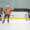 Goalie Cam Parent positions himself to defend the cross ice pass