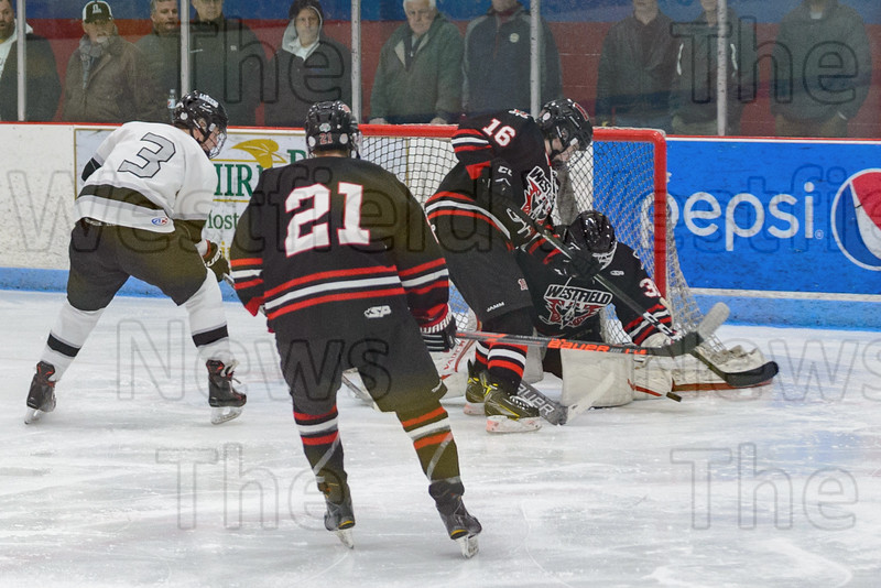 Goalie Cam Parent makes the stop and defenseman Liam Webster protects the crease