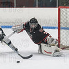 Westfield goalie Cam Parent and Longmeadow forward Spencer Robbins both stretch out for the puck