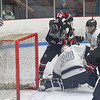 Westfield forward Connor Cottengim jams at the puck