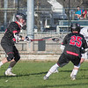 Danny Buckelew (25) and Zachary Cree (36) double team the Longmeadow player to force a ground ball