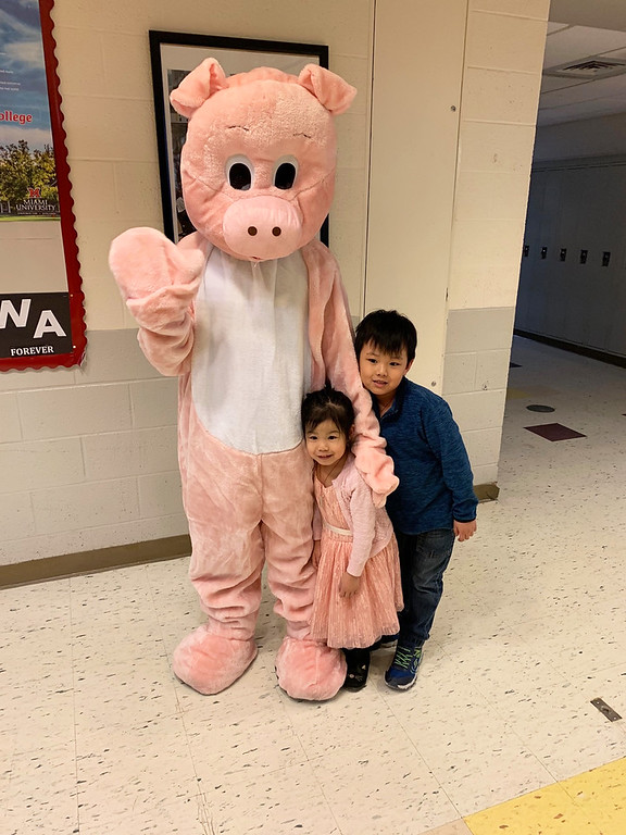 . Sam the pig celebrates the year of the pig with Zoe and Connor Nguyen of Malden