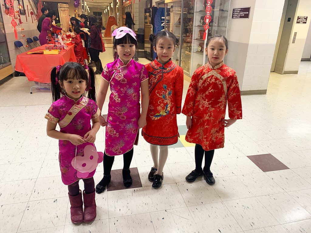 . Adorable young girls prepare for their performance.
