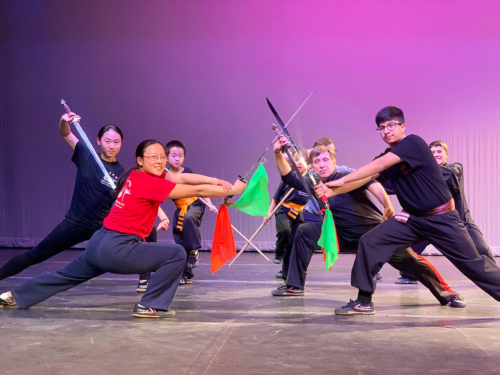 . The Chinese Martial Arts Division of Athletic Balance, LLC, rehearse before a performance.