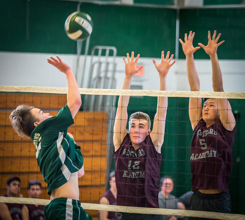 . Billerica\'s senior middler, Roland McMahon, (L) comes down with a slam and a point againt Westford\'s Tom Burke (center) and Eric Porter.  Westford won the competition, game 1, 25-4, game 2, 25-11, and game 3, 25-23. Photo:  SUN/Scot Langdon