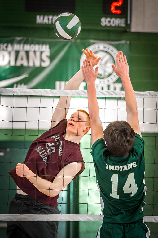 . Westford\'s Senior Cam Tierney, (L) takes the spike to Billerica\'s middler, Jeff Davis, during Monday\'s volleyball game.  Westford won the competition, game 1, 25-4, game 2, 25-11, and game 3, 25-23. Photo:  SUN/Scot Langdon