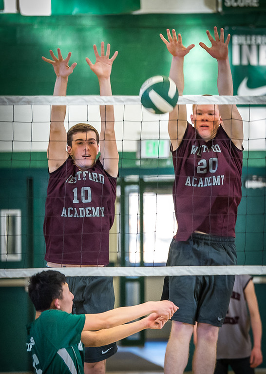 . Westford\'s Seniors Matt Robertson, (L) and Cam Tierney successfully stuff the shot from Billerica\'s Junior, Alex Yeh.    Westford won the competition, game 1, 25-4, game 2, 25-11, and game 3, 25-23. Photo:  SUN/Scot Langdon