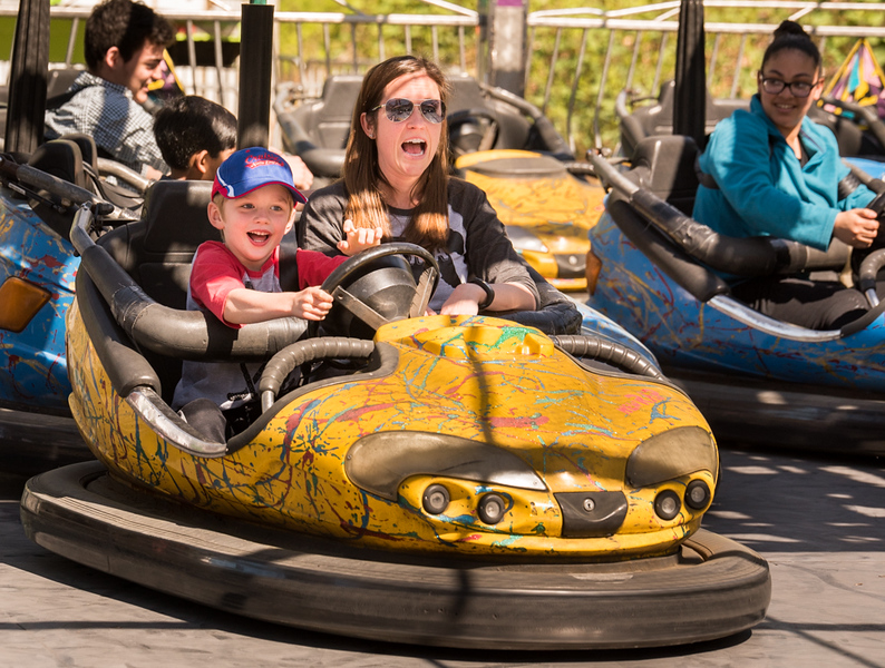 . Bumper Car enthusiasts, Brady Kelly, (L), 6, of Westford, and his mother, Amy Lundquist, prepare  for a crash with other drivers at the  Annual Apple Blossom Festival in Westford on Sunday.  Photo: SUN/Scot Langdon