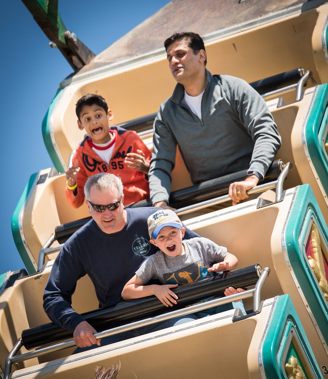 . RIDING THE EGYPTIAN BOAT  Festival goers, Shaunak Kundalkar, 10, top left of Westford, his father, Sidd, and bottom left Brad Felton of Stow, and his son, Blake, 7, enjoy an uplifting time on the Egyptian Boat ride at the annual Apple Bossom Festival fair in Westford on Sunday.  The festival was organized by the Kiwanis Club of Westford and took place at the Abbot Elementary School.  Photo:  SUN/Scot Langdon