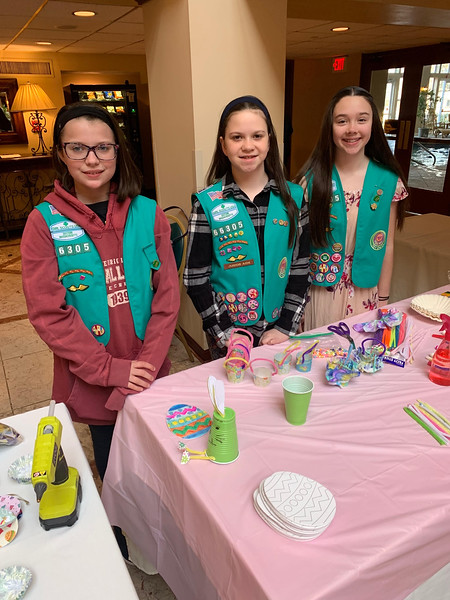 Girl Scouts of Westford Troop 66305, from left, Aida DiBisceglie, Makayla Cassie and Kristyn Landers, all of Westford