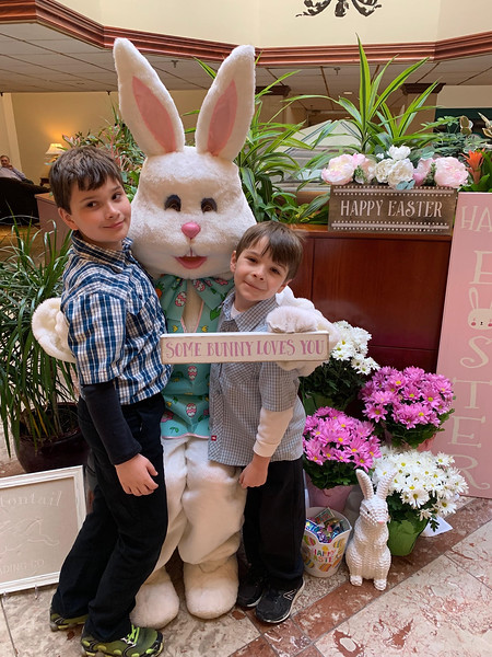 The Easter Bunny hugs Ben and Kai Anderson of Westford.