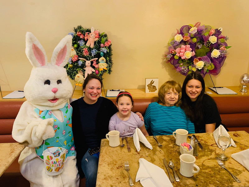 The Easter Bunny poses with, from left, Lindsay and Sierra Thomassen, Sheila Parent and Brianna Feliciano, all of Connecticut.