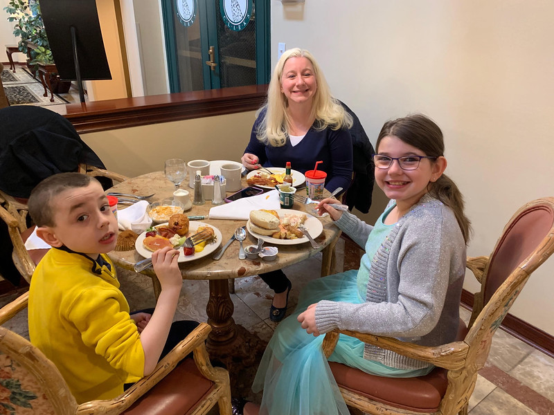 Amanda Arria of Westford enjoys breakfast with Andrew and Abby.