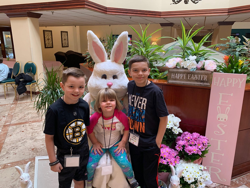 Nate, Mallory and Jack St. Gelais of Tyngsboro hang with the Easter Bunny.