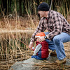 Brandon LaBelle of Westford helps his 2 year old son, Sawyer go fishing at the Fishing Derby held at Westford Sportsmen's Club. SUN/Caley McGuane