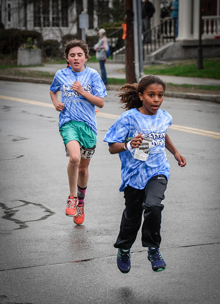 Alexis Thermiror, 10, from Acton takes the lead in the Family Fun Run with Molly Henderson, 13, from Westford close behind her. SUN/Caley McGuane