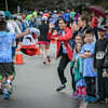 Spectators clap and high-five runners participating in the 5k race in Westford. SUN/Caley McGaune