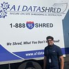 Joel Maldonado, customer-service rep for A1 Datashred of Tewksbury, had his hands full.