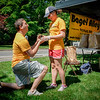 Having met eachother at a food festival, Colby Fleckner of Westford proposed to his girlfriend, Tara Lynch of Westford while working at the Bagel Alley tent at the Westford Strawberry and Arts Festival on Saturday. SUN/Caley McGuane