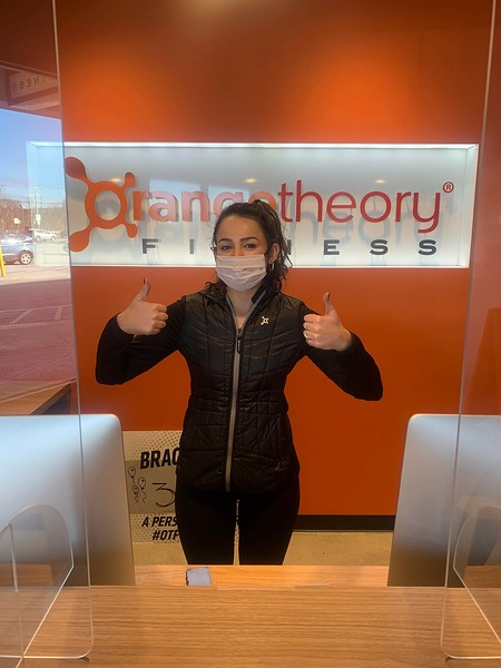 Chloe Ellis of Lowell give two thumbs up to Orangetheory Fitness..