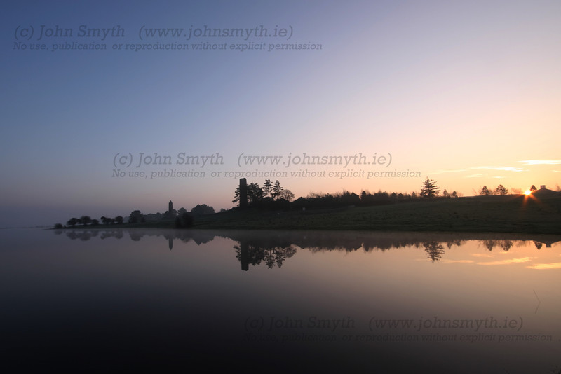 Sunrise at Clonmacnoise holy site on the bank of the River Shannon in Co. Westmeath, Ireland.