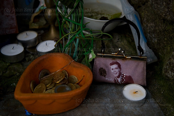 Offerings left at St. Brigid's Holy Well, in Killare, Co. Westmeath [near the Hill of Uisneach], including a Cliff Richards purse. Cliff, a devout Christian, doesn't appear to have aged a bit in the last fifty years - it must be a miracle!